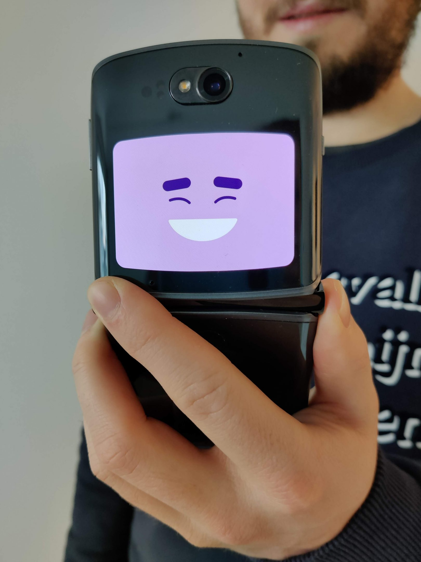 smartphone with extra screen with smiley on it